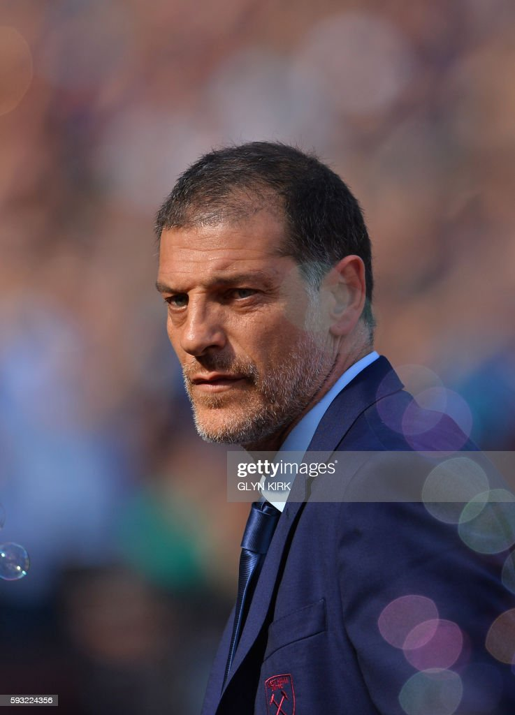 West Ham United's Croatian manager Slaven Bilic looks through the bubbles ahead of the English Premier League football match between West Ham United and Bournemouth at The London Stadium, in east London on August 21, 2016, West Ham's first home Premier League fixture in their new stadium. / AFP PHOTO / Glyn KIRK / RESTRICTED TO EDITORIAL USE. No use with unauthorized audio, video, data, fixture lists, club/league logos or 'live' services. Online in-match use limited to 75 images, no video emulation. No use in betting, games or single club/league/player publications. /