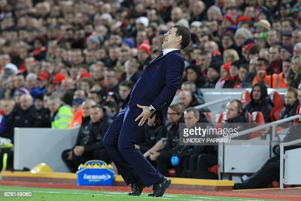 West Ham United's Croatian manager Slaven Bilic reacts on the touchline during the English Premier League football match between Liverpool and West...