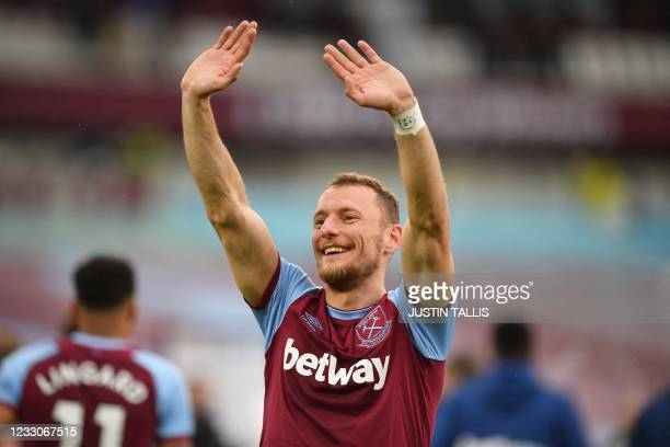 West Ham United's Czech defender Vladimir Coufal celebrates on the pitch after the English Premier League football match between West Ham United and...