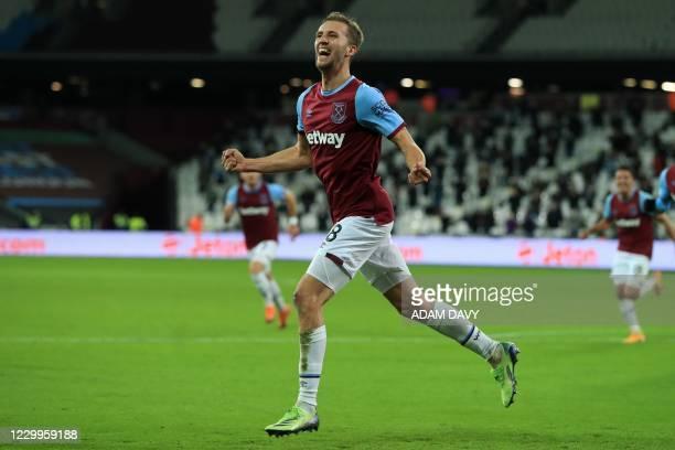 West Ham United's Czech midfielder Tomas Soucek celebrates scoring the opening goal during the English Premier League football match between West Ham...