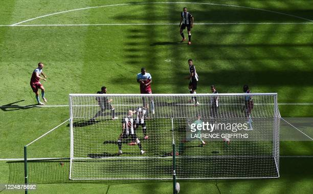 West Ham United's Czech midfielder Tomas Soucek shoots and scores a goal during the English Premier League football match between Newcastle United...