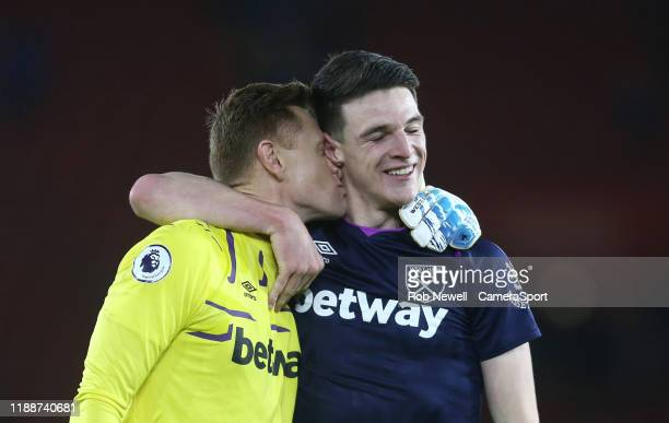 West Ham United's David Martin gives Declan Rice a kiss as they celebrate at the end of the game during the Premier League match between Southampton...