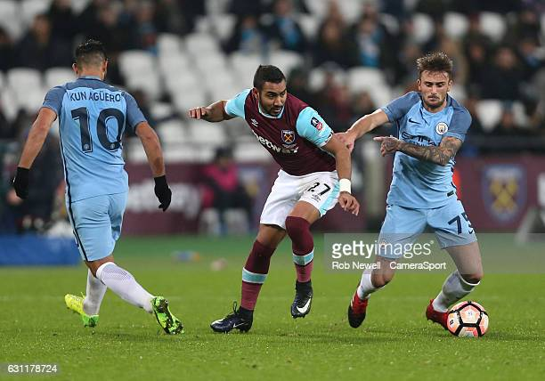 West Ham United's Dimitri Payet gets in between Manchester City's Sergio Aguero and Aleix Garcia during the Emirates FA Cup Third Round match between...
