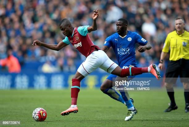 West Ham United's Emmanuel Emenike and Leicester City's Jeffrey Schlupp battle for the ball