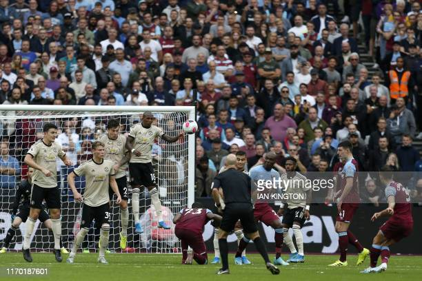 West Ham United's English defender Aaron Cresswell takes a free kick during the English Premier League football match between West Ham United and...
