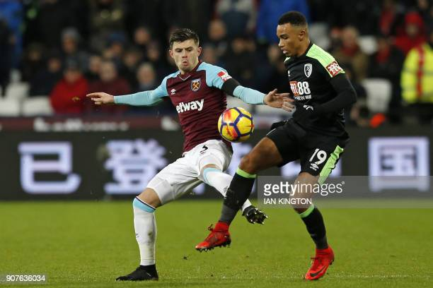West Ham United's English defender Aaron Cresswell vies with Bournemouth's English midfielder Junior Stanislas during the English Premier League...