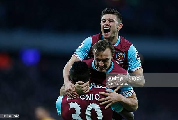 West Ham United's English defender Aaron Cresswell West Ham United's English midfielder Mark Noble and West Ham United's English midfielder Michail...