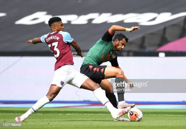 West Ham United's English defender Ben Johnson tackles Aston Villa's Egyptian midfielder Trezeguet during the English Premier League football match...