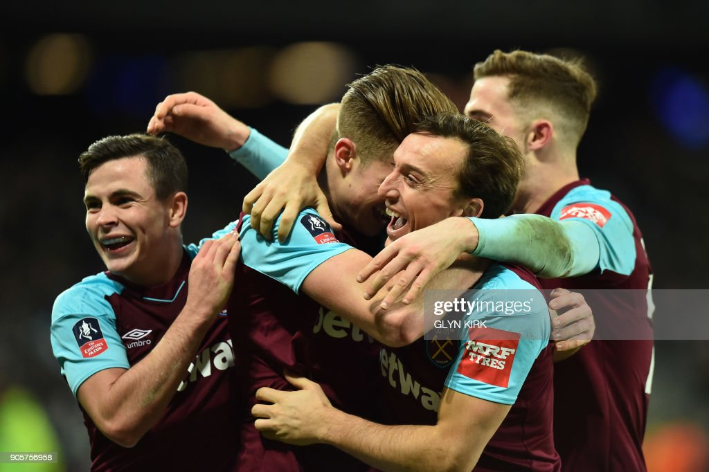 West Ham United's English defender Reece Burke (2L) celebrates scoring the team's first goal with teammates during the FA Cup third round replay football match between West Ham United and Shrewsbury Town at The London Stadium, in east London on January 16, 2018. / AFP PHOTO / Glyn KIRK / RESTRICTED TO EDITORIAL USE. No use with unauthorized audio, video, data, fixture lists, club/league logos or 'live' services. Online in-match use limited to 75 images, no video emulation. No use in betting, games or single club/league/player publications. /