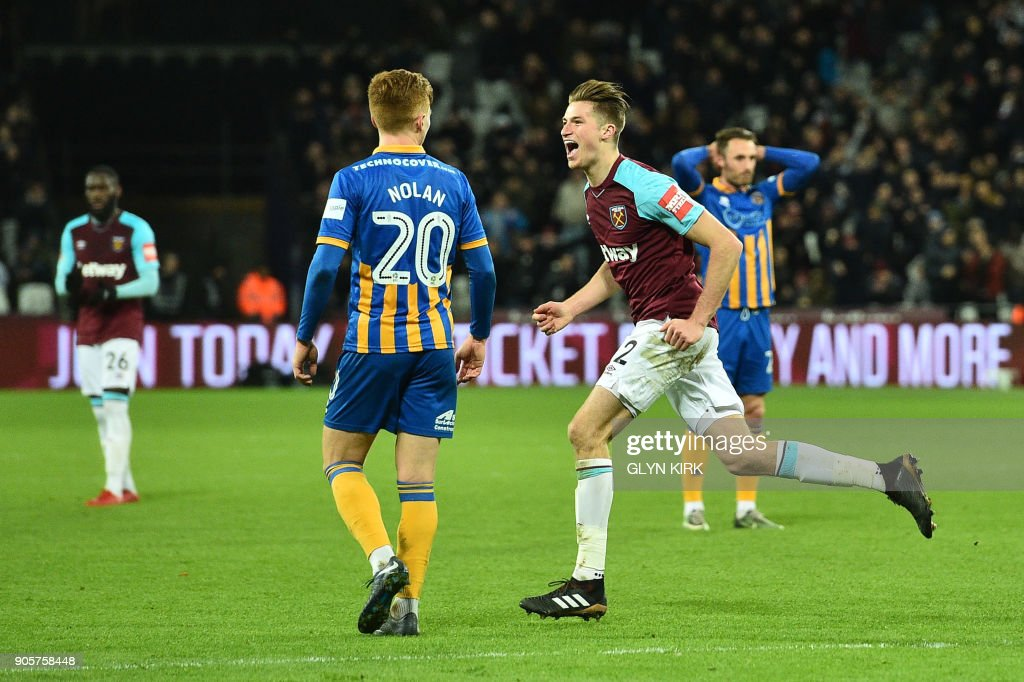 West Ham United's English defender Reece Burke celebrates scoring the team's first goal during the FA Cup third round replay football match between West Ham United and Shrewsbury Town at The London Stadium, in east London on January 16, 2018. / AFP PHOTO / Glyn KIRK / RESTRICTED TO EDITORIAL USE. No use with unauthorized audio, video, data, fixture lists, club/league logos or 'live' services. Online in-match use limited to 75 images, no video emulation. No use in betting, games or single club/league/player publications. /