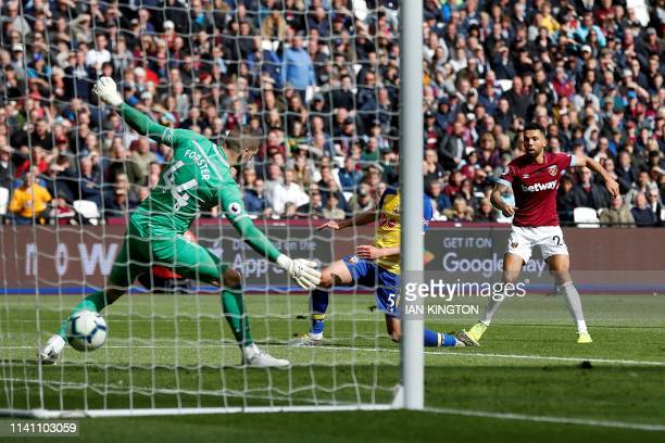 West Ham United's English defender Ryan Fredericks scores his team's third goal past Southampton's English goalkeeper Fraser Forster during the...