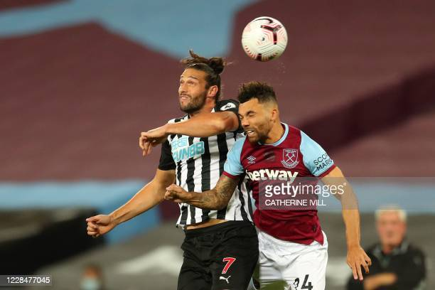 West Ham United's English defender Ryan Fredericks vies for the ball against Newcastle United's English striker Andy Carroll during the English...