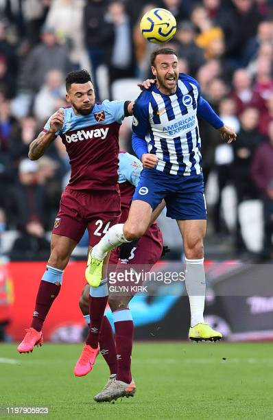 West Ham United's English defender Ryan Fredericks vies with Brighton's English striker Glenn Murray to header the ball during the English Premier...