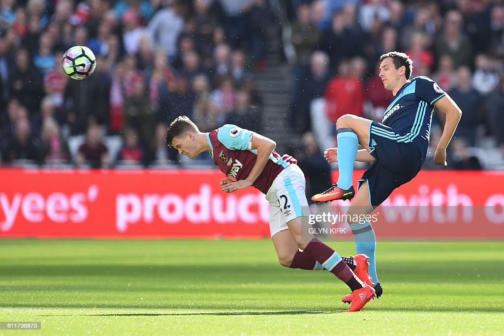 TOPSHOT - West Ham United's English defender Sam Byram (L) heads the ball early in the English Premier League football match between West Ham United and Middlesbrough at The London Stadium, in east London on October 1, 2016. / AFP / GLYN KIRK / RESTRICTED TO EDITORIAL USE. No use with unauthorized audio, video, data, fixture lists, club/league logos or 'live' services. Online in-match use limited to 75 images, no video emulation. No use in betting, games or single club/league/player publications. /