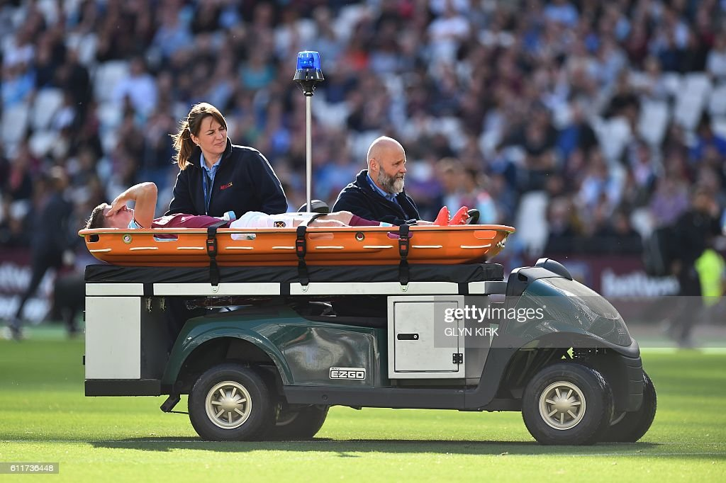 TOPSHOT - West Ham United's English defender Sam Byram is stretchered off the field injured during the English Premier League football match between West Ham United and Middlesbrough at The London Stadium, in east London on October 1, 2016. / AFP / GLYN KIRK / RESTRICTED TO EDITORIAL USE. No use with unauthorized audio, video, data, fixture lists, club/league logos or 'live' services. Online in-match use limited to 75 images, no video emulation. No use in betting, games or single club/league/player publications. /