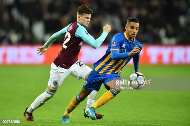 West Ham United's English defender Sam Byram vies with Shrewsbury Town's English defender Max Lowe during the FA Cup third round replay football...
