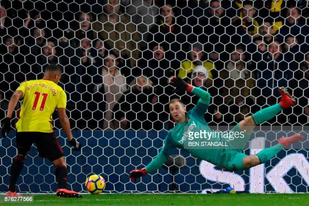 West Ham United's English goalkeeper Joe Hart makes a save from a shot from Watford's Brazilian striker Richarlison de Andrade during the English...