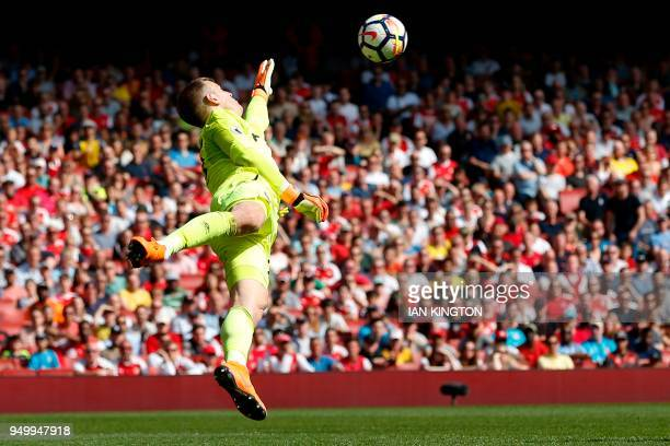 West Ham United's English goalkeeper Joe Hart saves a shot from Arsenal's English striker Danny Welbeck during the English Premier League football...