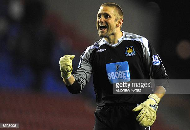 West Ham United's English goalkeeper Robert Green celebrates at the final whistle after his teams 1-0 victory over Wigan in the English Premier...