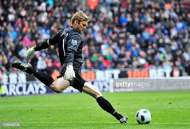 West Ham United's English goalkeeper Robert Green kicks the ball during the English Premier League football match against Wigan Athletic at The DW...