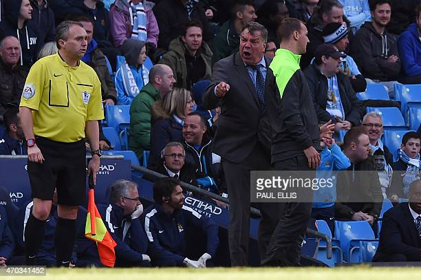 West Ham United's English manager Sam Allardyce reacts after a decision against his team between assistant referee Darren Cann and fourth official...