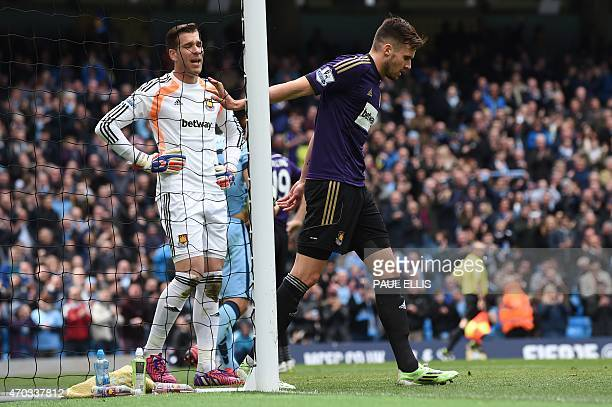 West Ham United's English midfielder Carl Jenkinson and West Ham United's Spanish goalkeeper Adrian react after the ball bounces into the goal after...