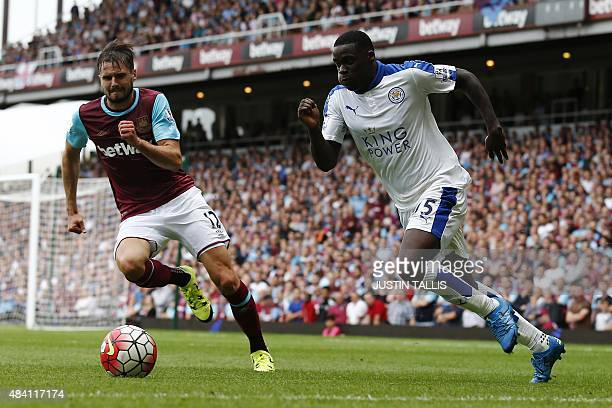 West Ham United's English midfielder Carl Jenkinson vies with Leicester City's Ghanaian striker Jeff Schlupp during the English Premier League...