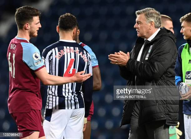 West Ham United's English midfielder Declan Rice shakes hands with sam West Bromwich Albion's English head coach Sam Allardyce after the English...