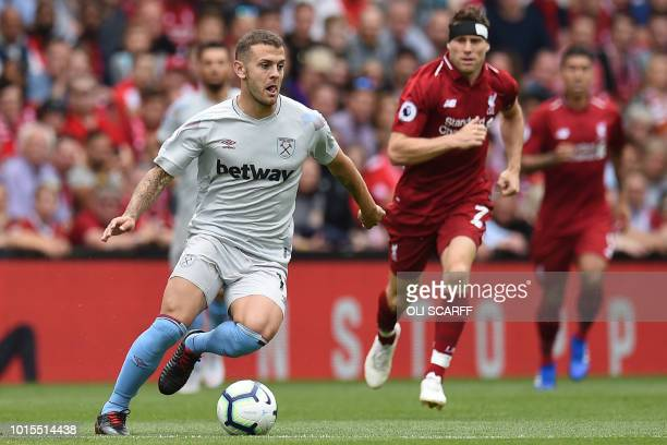 West Ham United's English midfielder Jack Wilshere runs with the ball during the English Premier League football match between Liverpool and West Ham...