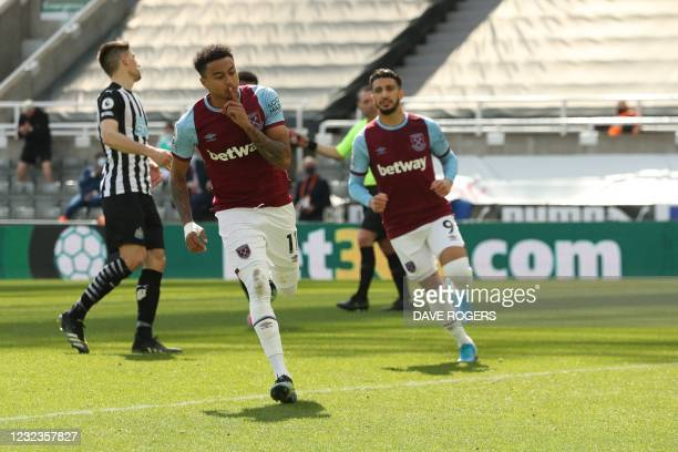 West Ham United's English midfielder Jesse Lingard celebrates after scoring a goal during the English Premier League football match between Newcastle...