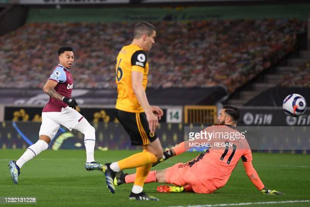 West Ham United's English midfielder Jesse Lingard scores the opening goal of the English Premier League football match between Wolverhampton...