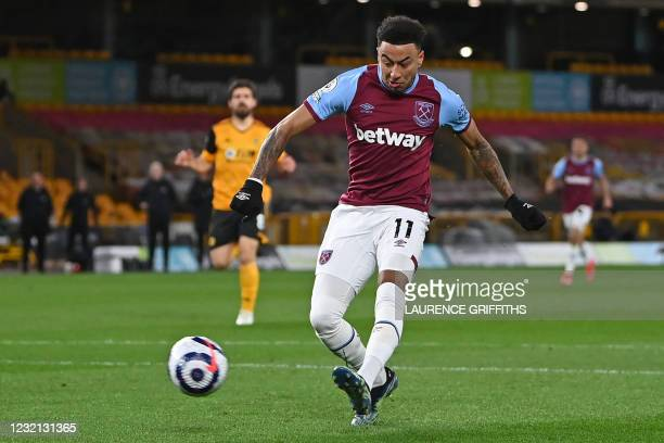 West Ham United's English midfielder Jesse Lingard shoots to score the opening goal during the English Premier League football match between...