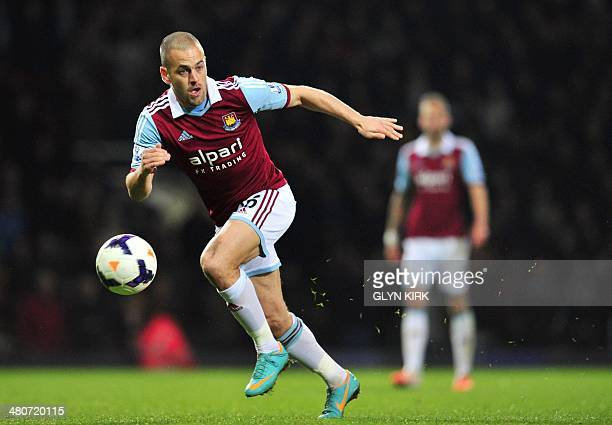West Ham United's English midfielder Joe Cole runs after the ball during the English Premier League football match between West Ham United and Hull...