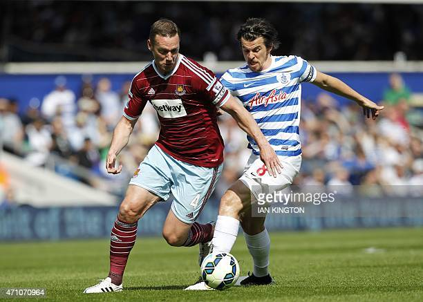 West Ham United's English midfielder Kevin Nolan vies with Queens Park Rangers English midfielder Joey Barton during the English Premier League...