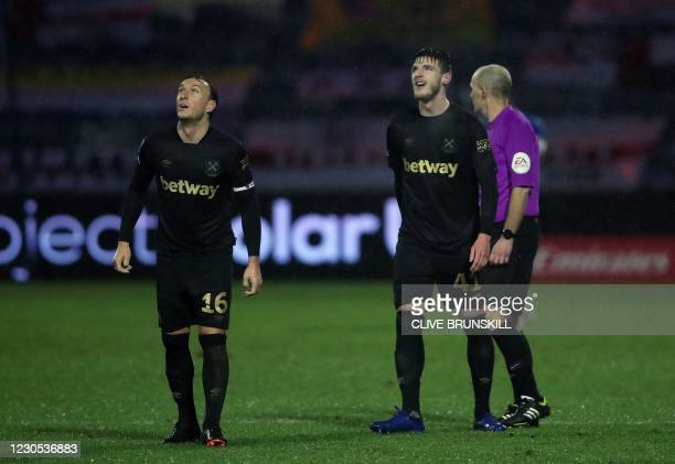 West Ham United's English midfielder Mark Noble and West Ham United's English midfielder Declan Rice watches fireworks as they explode in the air, as...