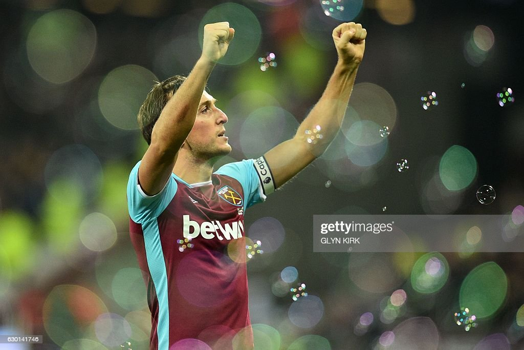 West Ham United's English midfielder Mark Noble celebrates after scoring the opening goal from the penalty spot during the English Premier League football match between West Ham United and Hull City at The London Stadium, in east London on December 17, 2016. / AFP / Glyn KIRK / RESTRICTED TO EDITORIAL USE. No use with unauthorized audio, video, data, fixture lists, club/league logos or 'live' services. Online in-match use limited to 75 images, no video emulation. No use in betting, games or single club/league/player publications. /