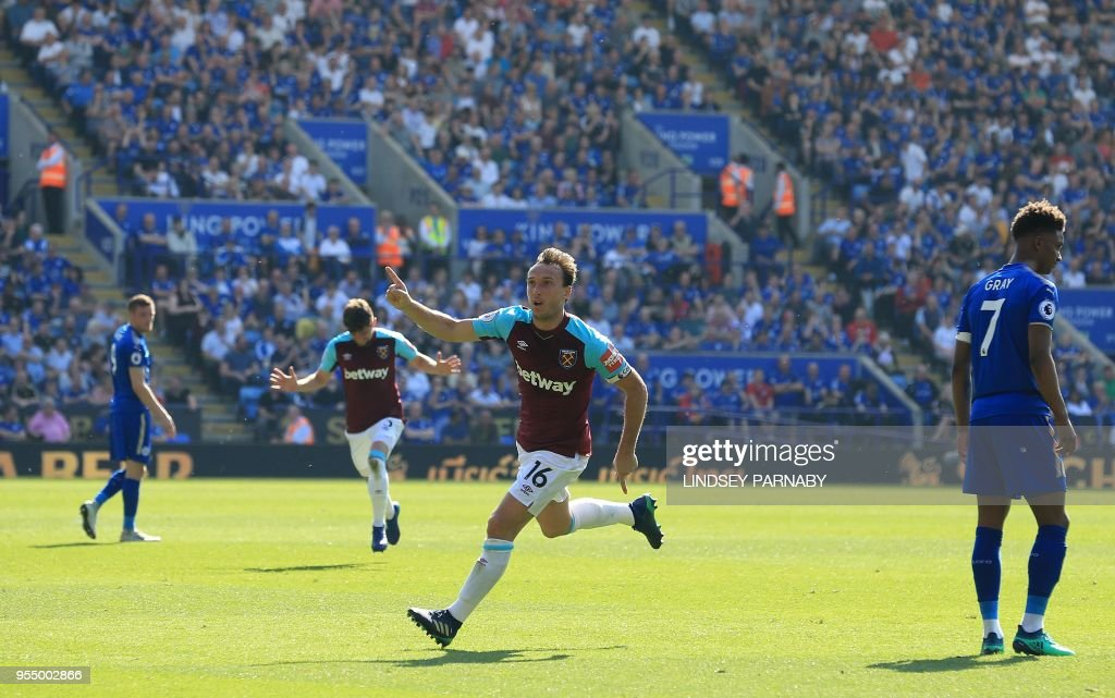 West Ham United's English midfielder Mark Noble (C) celebrates scoring his team's second goal during the English Premier League football match between Leicester City and West Ham United at King Power Stadium in Leicester, central England on May 5, 2018. (Photo by Lindsey PARNABY / AFP) / RESTRICTED TO EDITORIAL USE. No use with unauthorized audio, video, data, fixture lists, club/league logos or 'live' services. Online in-match use limited to 75 images, no video emulation. No use in betting, games or single club/league/player publications. /