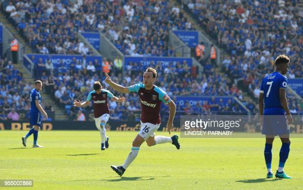 West Ham United's English midfielder Mark Noble celebrates scoring his team's second goal during the English Premier League football match between...