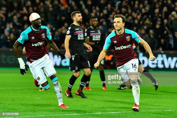 West Ham United's English midfielder Mark Noble celebrates scoring their first goal to equalise 11 during the English Premier League football match...