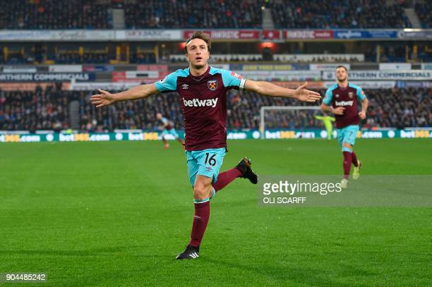 West Ham United's English midfielder Mark Noble celebrates scoring the opening goal during the English Premier League football match between...