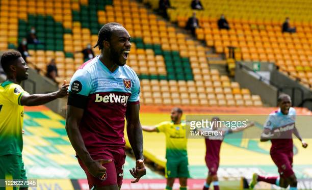 West Ham United's English midfielder Michail Antonio celebrates after scoring a goal during the English Premier League football match between Norwich...