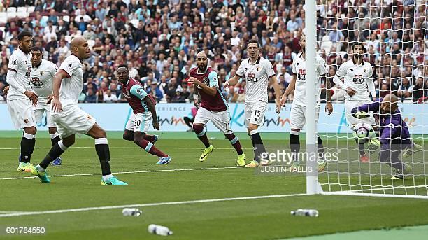 West Ham United's English midfielder Michail Antonio celebrates scoring his team's first goal during the English Premier League football match...