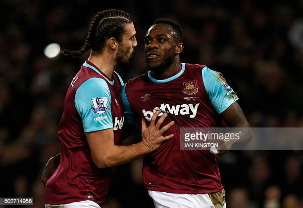 West Ham United's English midfielder Michail Antonio celebrates with West Ham United's English striker Andy Carroll after scoring their first goal...