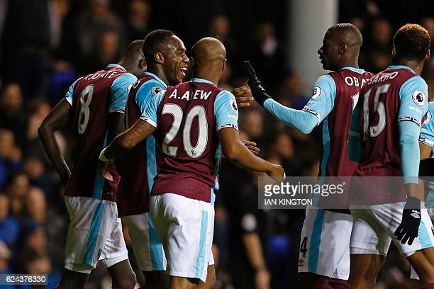 West Ham United's English midfielder Michail Antonio celebrates with teammates after scoring the opening goal of the English Premier League football...
