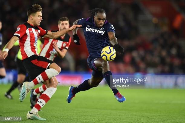 West Ham United's English midfielder Michail Antonio has a goal disallowed after the ball appears to come off his hand in the build-up during the...