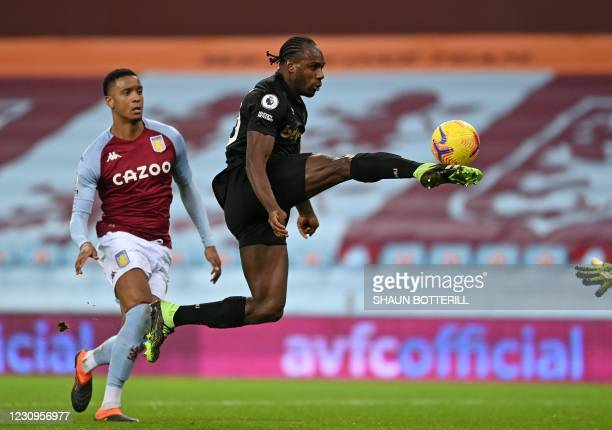 West Ham United's English midfielder Michail Antonio lobs the goalkeeper only for his shot to be cleared off the goal line during the English Premier...
