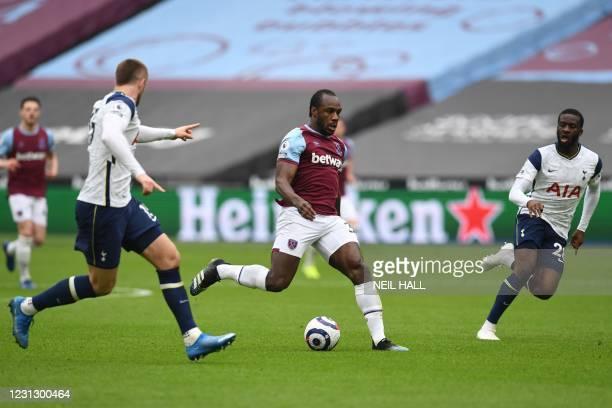 West Ham United's English midfielder Michail Antonio runs through the Tottenham defence during the English Premier League football match between West...