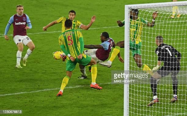 West Ham United's English midfielder Michail Antonio scores his team's second goal during the English Premier League football match between West Ham...