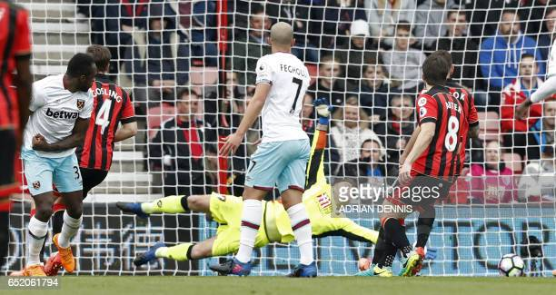 West Ham United's English midfielder Michail Antonio scores the opening goal past Bournemouth's Polish goalkeeper Artur Boruc during the English...