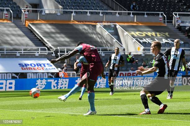 West Ham United's English midfielder Michail Antonio shoots and scores a goal during the English Premier League football match between Newcastle...